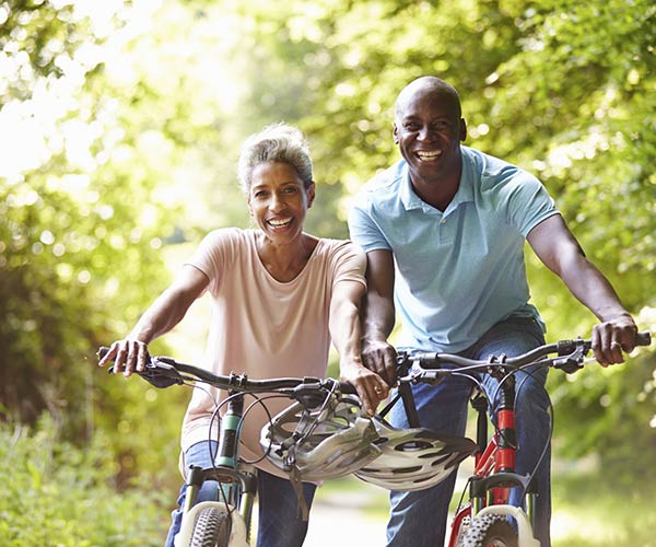 Adult man and his mother riding bikes