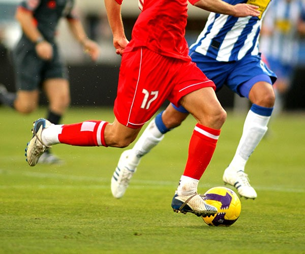 close up of knees of soccer players during play